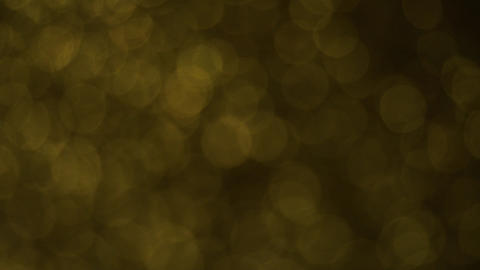 Slowly Rotating Dark Yellow Bokeh Animation