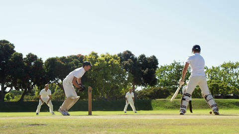 Batsman hitting a ball during cricket match Live Action