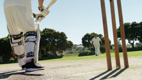Batsman playing a defensive stroke during cricket match Live Action