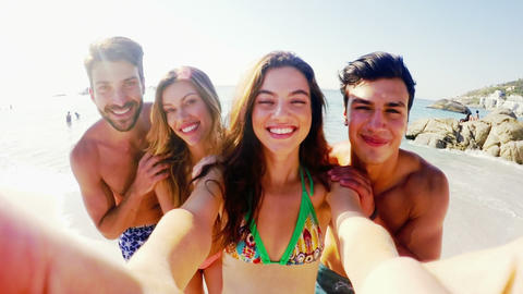 Happy friends having fun at the beach on a sunny day Live Action