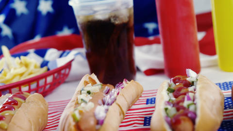 Hamburgers and cold drink served on American flag Live Action