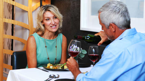 Mature couple interacting with each other in restaurant Live Action