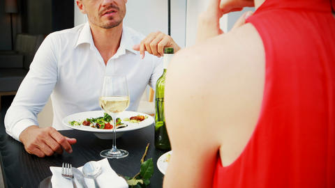 Couple interacting with each other during lunch Live Action