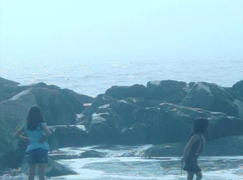 Ocean Waves 04 Girls playing with splash_1min Stock Video Footage