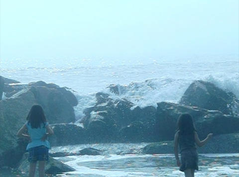 Ocean Waves 04 Girls Playing With Splash_1min stock footage