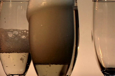 Four Champagne Glasses Spin 1 Stock Video Footage
