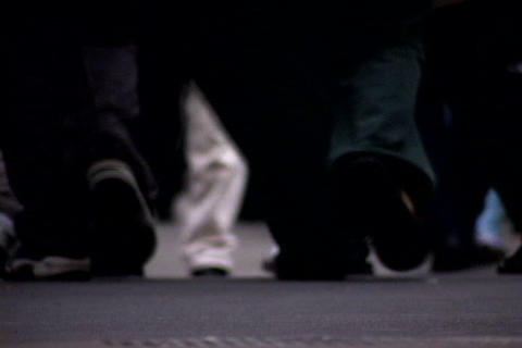 Close up of walking feet at crowded sidewalk 2 Footage