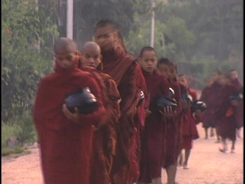 Buddhist monks collect alms in the morning Footage
