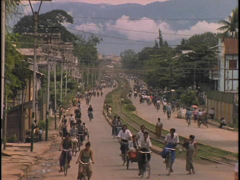 Pedestrians walk down a busy street Stock Video Footage