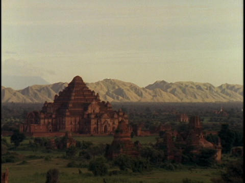 An ancient temple sits near mountains Stock Video Footage