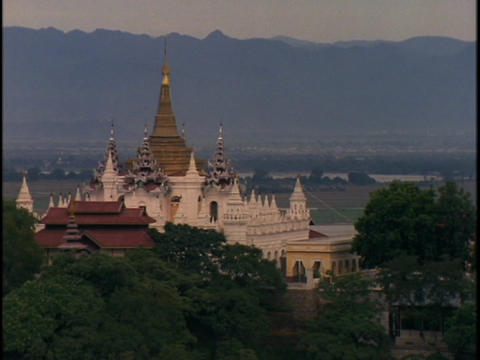 A beautiful, ancient Buddhist temple stands in front of a... Stock Video Footage