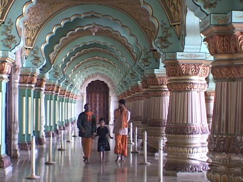 Indians walk through a Maharaja palace in India Footage