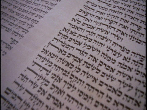 Ancient Hebrew letters cover a Torah scroll Stock Video Footage