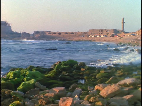 The sea crashes against the shore near ancient Roman ruins Footage