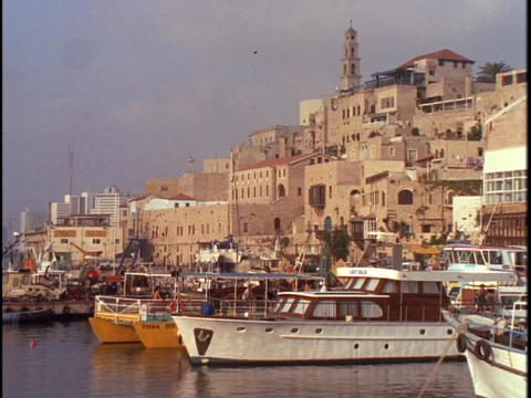 Boats float at the Jaffa, Israel port Stock Video Footage
