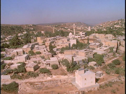 A mosque stands at the center of a Palestinian village in... Stock Video Footage