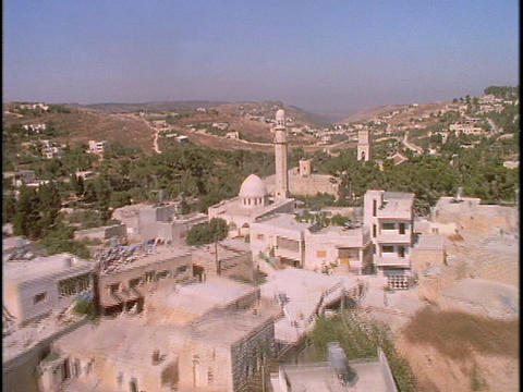 A mosque stands at the center of a Palestinian village in this stunning aerial shot Footage