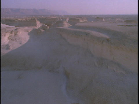 Mountains rise out of a barren desert in this spectacular... Stock Video Footage