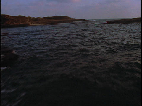 Waves lap the shore Stock Video Footage