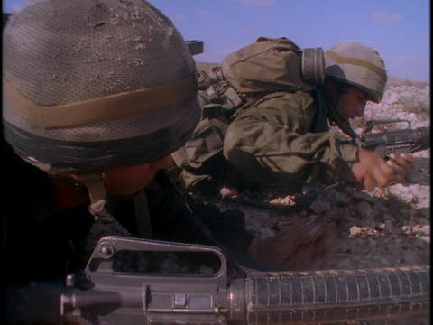 Soldiers train in the desert with guns Stock Video Footage