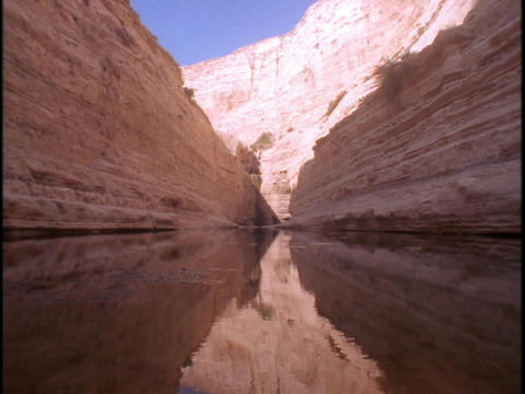 A small lake fills a canyon Stock Video Footage