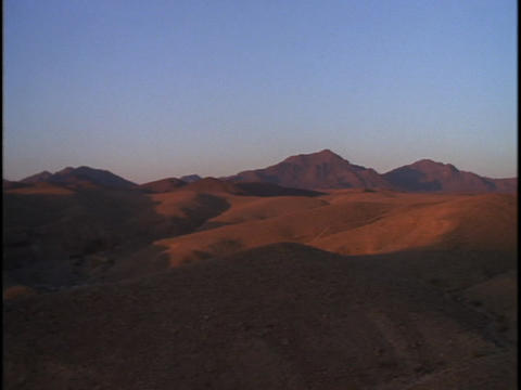 The sun shines down on the mountains at Negev, Israel Stock Video Footage