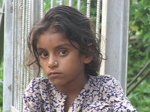 A young Indian girl nervously looks around Stock Video Footage