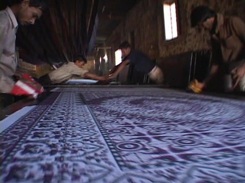 Workers make prints in a carpet factory Footage