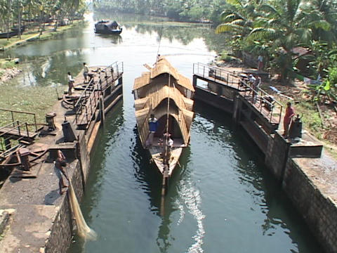 A riverboat floats into a canal Stock Video Footage