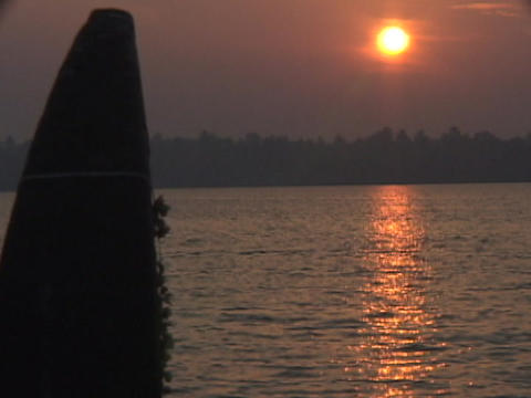 The golden hour sun reflects across a river Stock Video Footage