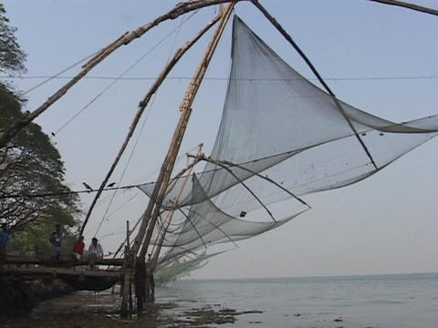 Fishing nets hang along the coast in Kerala, India Stock Video Footage