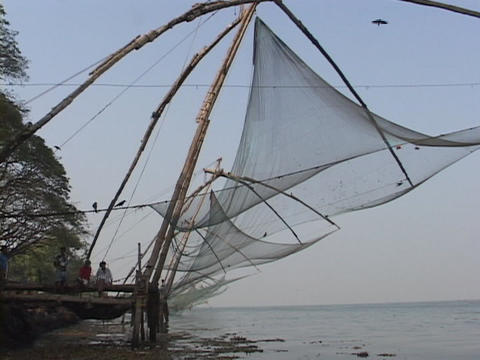 Fishing nets hang along the coast in Kerala, India Footage