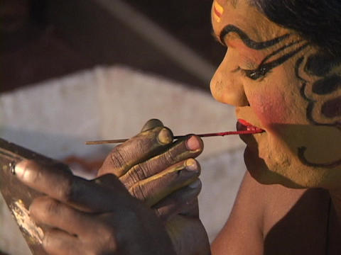An actor applies his makeup for a Kathakali Dance... Stock Video Footage