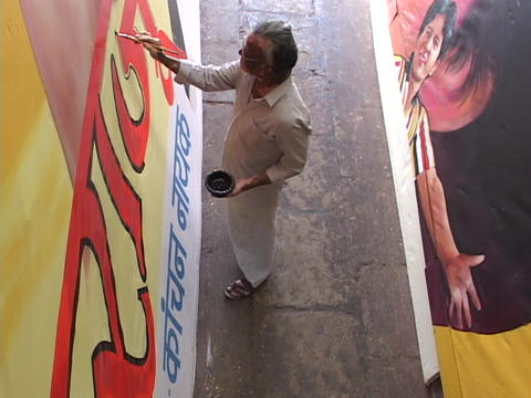 An artist paints in his studio Stock Video Footage