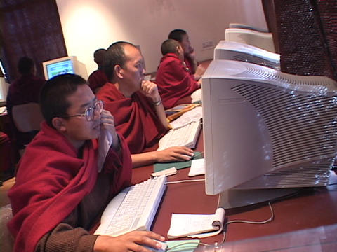 A group of Buddhist monks work on computers Stock Video Footage