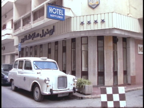 A man walks past Hotel Mayflower in Beirut, Lebanon Stock Video Footage