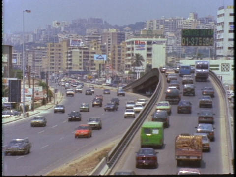 Heavy car traffic drives on an overpass in Beirut, Lebanon Stock Video Footage