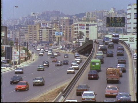 Heavy car traffic drives on an overpass in Beirut, Lebanon Footage