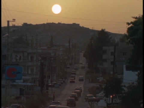 Traffic drives through a village in Lebanon Stock Video Footage