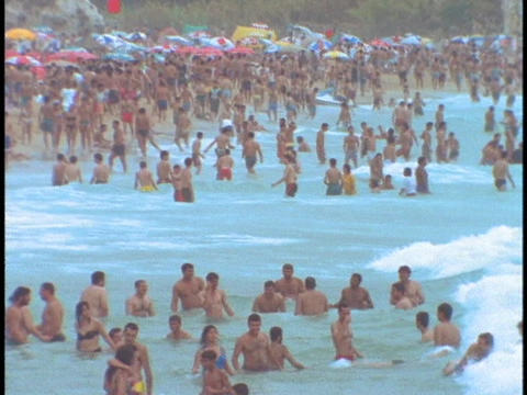 Tourists play at a crowded beach near Beirut Stock Video Footage