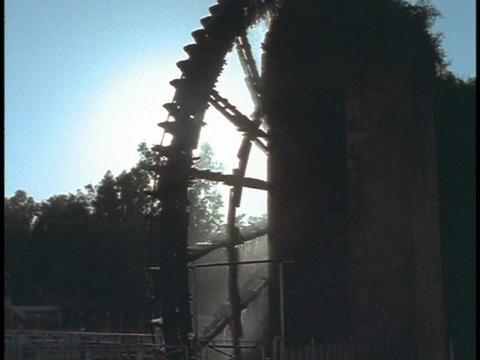 A waterwheel turns at a mill in Hama, Syria Stock Video Footage