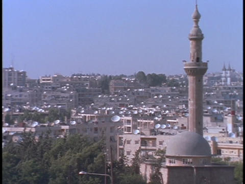 Satellite dishes dot the rooftops in Alleppo, Syria Footage