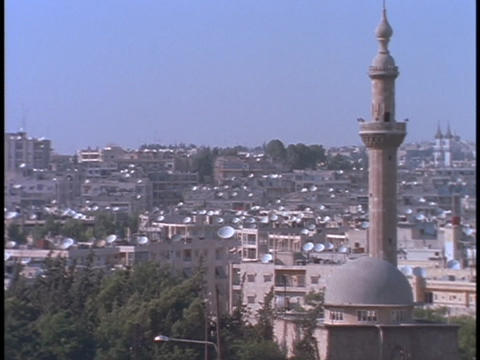 Satellite dishes dot the rooftops in Alleppo, Syria Stock Video Footage