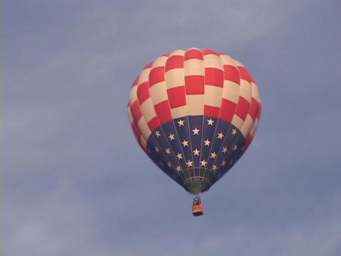 A hot air balloon flies through the sky Stock Video Footage