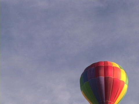 A colorful hot air floats through the sky Stock Video Footage