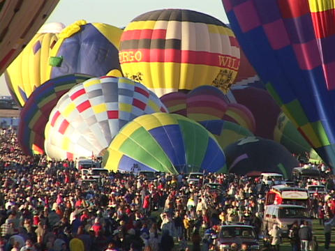 Crowds gather around hot air balloons at the Albuquerque... Stock Video Footage