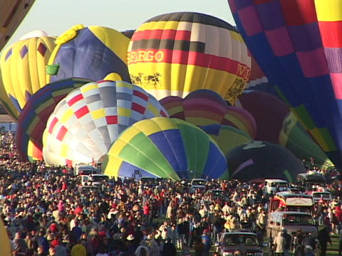 Crowds Gather Around Hot Air Balloons At The Albuquerque Balloon Festival. stock footage