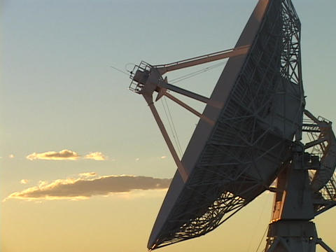 A golden sky lights the high points of a satellite dish... Stock Video Footage