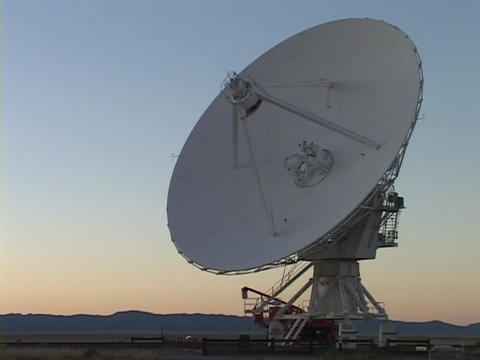 A satellite dish points skyward in New Mexico Stock Video Footage