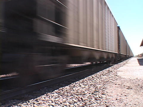 The cars of a freight train pass along the iron tracks Stock Video Footage